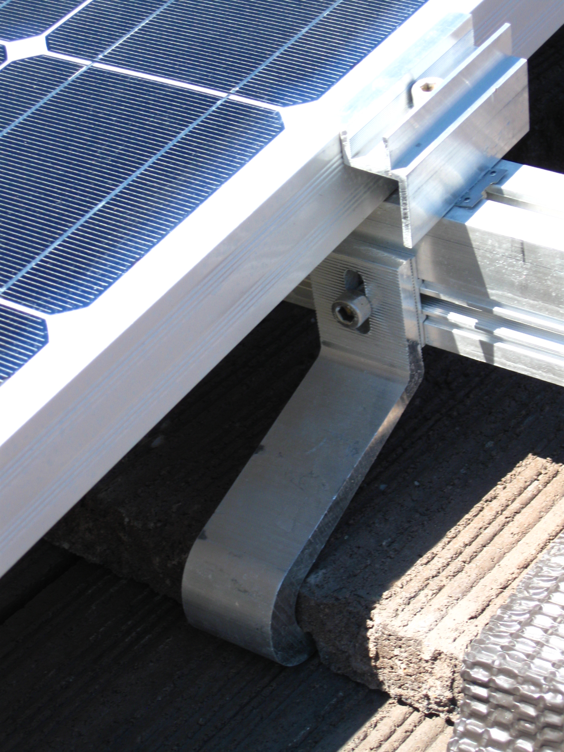 Solar Panel Attached to Racking System and Roof